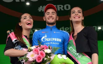 Russian rider Foliforov Alexander of Gazporm team celebrates on the podium after winnig the fifteenth stage of the Giro d'Italia 2016, long individual time trial from Castelrotto to Alpe di Susi 10,8 km, Italy, 22 May 2016 ANSA/LUCA ZENNARO